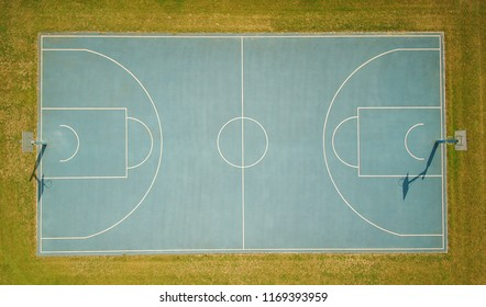 blue field futsal sport outdoor white line center aerial drone above the sky