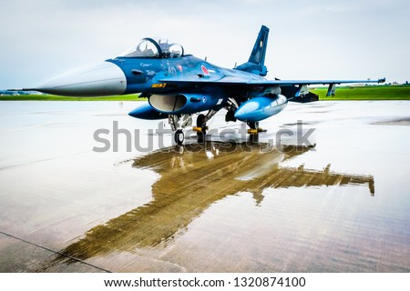 Blue fighter jet from