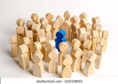The blue figure of the leader is surrounded by a crowd of people. Leadership and team management, an example for imitation. Loyalty and trust. Idol. Like-minded people and followers