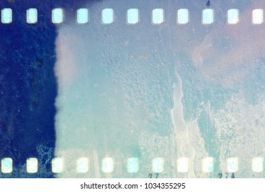 Blue film strip frame with wet glass of rain.