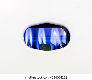 Blue fire burning gas nozzle gas water heater