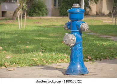 Blue fire hydrant in a city street for firefighters