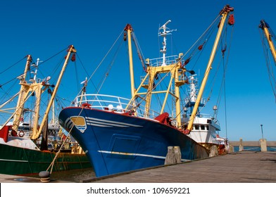 Blue fish boat or trawler in the harbor