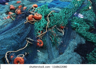 Blue fishernets are drying in the sun after fishing in the fisher port of Lom in Togo