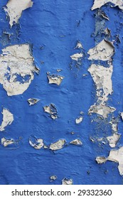 Blue flaky paint wall surface.
