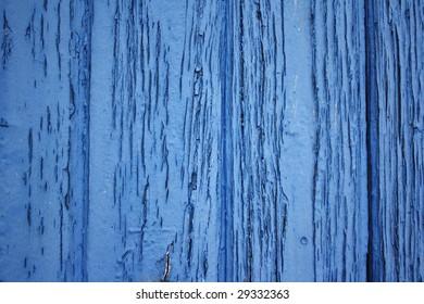 Blue flaky paint wood panels.