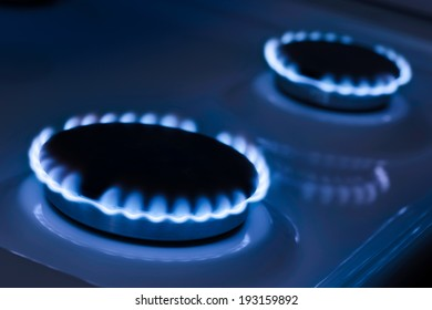 The blue flame from the burner of a gas stove