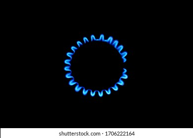 The blue flame of a cooker burner