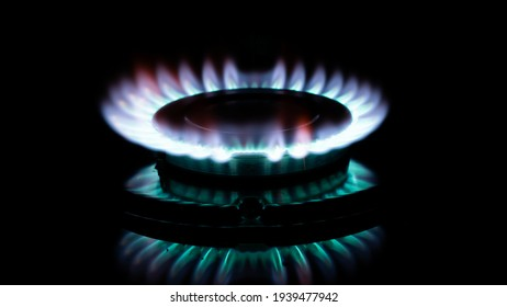 blue flame of a gas burner in the dark