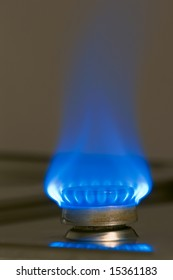 Blue flame of gas burner on kitchen stove