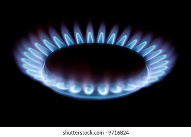 blue flame of gas on black