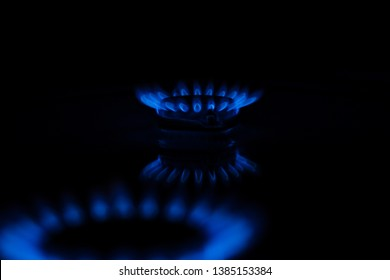 Blue flame of a gas stove in the dark. gas-burner