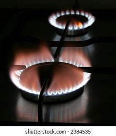Blue Flame Of A Stove Burner In Darkness Illustrating Combustion Of Gas