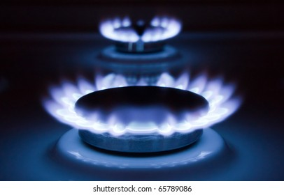 Blue flames of a burning natural gas. Gas cooker in action.