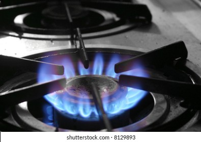 The blue flames of a gas powered stove top symbolize energy used for household purposes