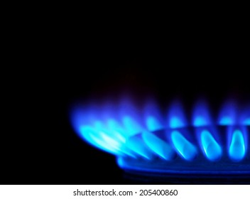 Blue flames of gas stove in the dark