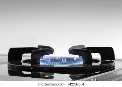 Blue flames on gas stove burner