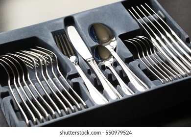 Blue flatware box isolated on black background