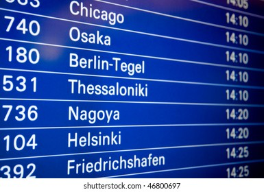Blue flight information board in airport, selective focus