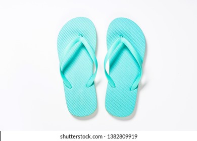 Blue flip flops on white. Top view.