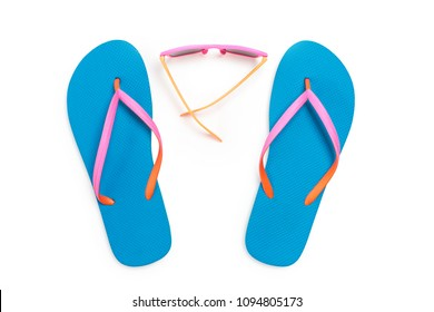 Blue Flip Flops and Pink Sunglasses Isolated on White Background. Top view