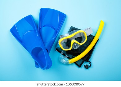 Blue flippers on color background