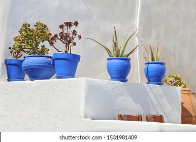 blue flower pots on white wall at Ano Koufonisi island Cyclades Greece