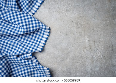 Blue folded tablecloth on gray stone table
