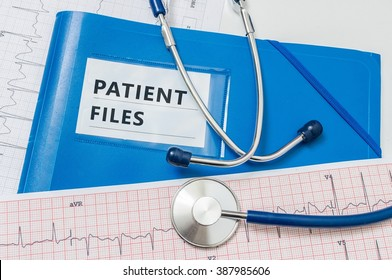 Blue folder with patient reports and files.