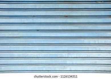 Blue Folding Metal Door Background.