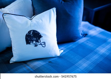 Blue football helmet on white pillow