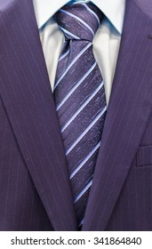Blue formal business suit with shirt and a stripy light blue tie background