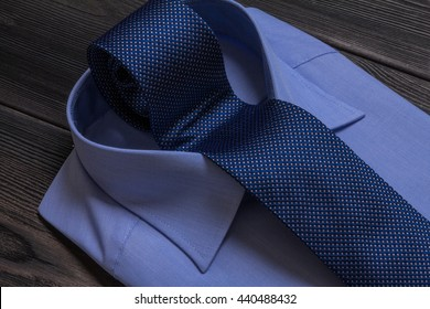 blue formal shirt and rolled necktie in collar