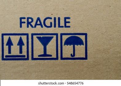 Blue fragile symbol on cardboard