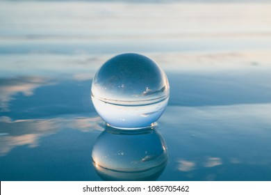 Blue freedom concept: The Crystal Ball reflecting water and sky in blue. Beautiful creative landscape photography
