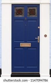 Blue front door, number 8