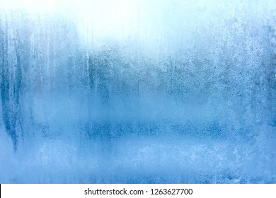 Blue Frost Background, Closeup Frozen Winter Window Pane Coated Shiny Icy Frost Patterns, Extreme North Low Temperature, Natural Ice Pattern on a Frosty Glass