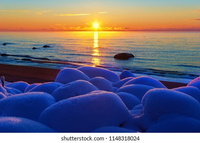 Blue frost on rocks during sunset