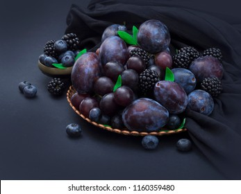 blue fruit on the table