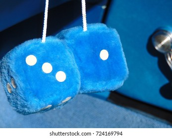 Blue Fuzzy dice inside of a collector car