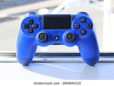 Blue game controller in white background