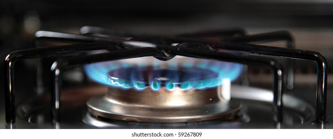 Blue gas jet of a domestic gas stove.