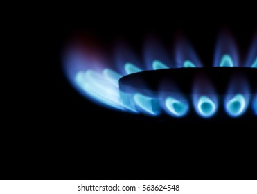 Blue gas on dark background. Energy saving concept