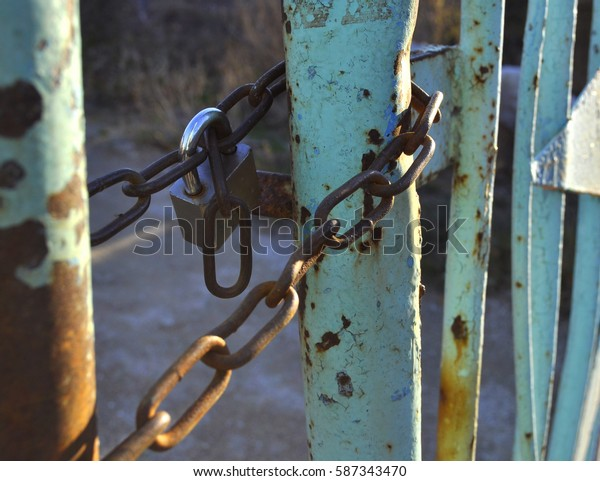 Blue gate closed on the chain and lock