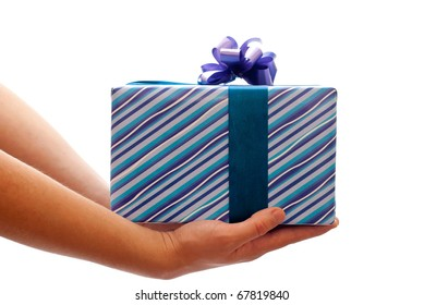 Blue gift box with bow in man's hands. Isolated on white