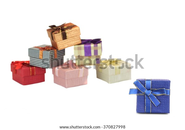 Blue Gift Box Closeup and Many Blurred Different Boxes In A Heap Isolated On  White Background,  Horizontal Image With Copy Space, Front View