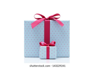 blue gift box on white background. Different sizes of the same shape gift box. A small gift box with a big gift box.