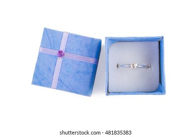Blue gift box with a ring open isolated on white background