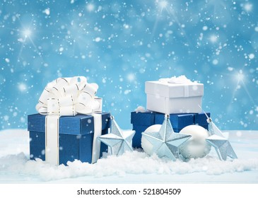 Blue gift boxes with christmas decoration on beautiful background