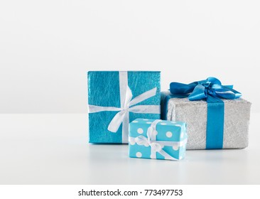 Blue gift boxes with ribbon on white